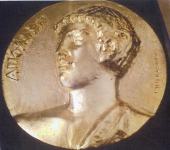 Gold-plated relief of the Greek god Apollo presented to Sgouros by UNESCO (May 2014)